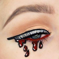 You don't have the time or effort to do a full face paint for Halloween, but you need still something gory AF.  Enter: the knifeliner. Basically, it's a Halloween-upgrade of your everyday winged liner, except you're replicating kitchen knives rather than cat eyes, and there's lots of blood.