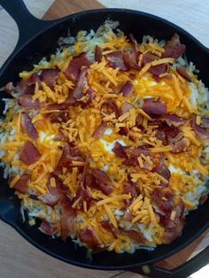 All the components of a perfect, hearty breakfast in one skillet---potatoes, cheese, bacon and eggs perfectly married in cast iron.