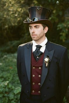 Steam punk wedding anyone? This cravat is tied and finished with a pin. The round collar is typical of the Victorian and Edwardian eras, and the dark brown cutaway waistcoat completes the look. jkt