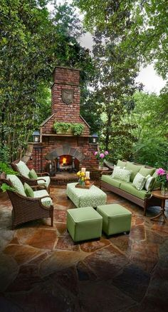 Like large scale mortared stone floor but would like to see low brick wall adjacent to fireplace to create sense of enclosure