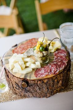 Place your charcuterie + cheese on a log-style board. Pairs well with the Summer Thyme Wild Turkey American Honey cocktail: http://americanhoney.com/recipes.php