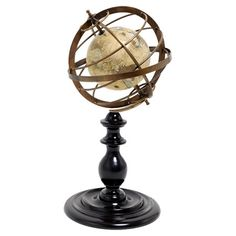 Globe in an armillary sphere on a spooled rosewood base.   Product: Globe décorConstruction Material: Brass and rosew...