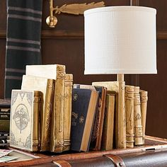HARRY POTTER™ Bookend Table Lamp - IT's bookends and a table lamp and I've never wanted a lamp more in my life!