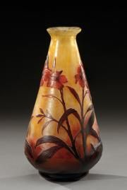 Daum Nancy~A conical shaped~Lined glass vase~Acid etched with a floral motifs on a partially hammered mottled background~Circa 1900