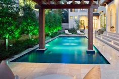 Pergola over pool by Exterior Worlds -Houston Landscape Design