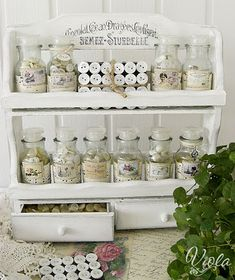 Vintage spice rack transformed for button storage. This website is great for some DIY shabby chic crafts.