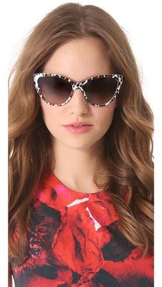 Stella McCartney Cat Eye Sunglasses...wonder how these would look on my ten head