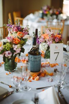 Floral Designer: Simply Elegant Floral Decorators | Low Floral Centerpieces, Peach and Lavender with Green accents.