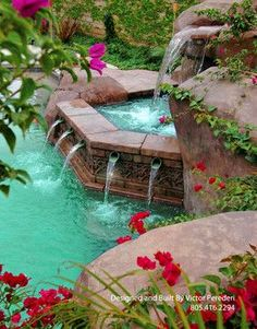 Gorgeous hot tub with water feature into pool.