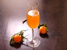 Champagne Glass with Apple Cider Cocktail, Next to Clementines So many on this website that I want to try this Holiday season :)