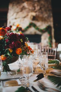 Marigold and Purple Centerpiece | photography by http://alisonvagnini.com/