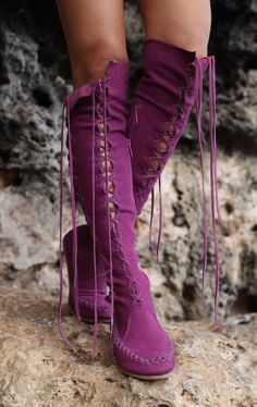 218 Purple knee high leather boots.