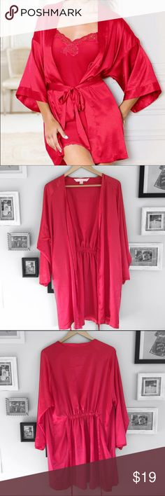 Victoria's Secret Robe Red Victoria's Secret silk robe. There is a tie. There are 2 little holes in the back which are pictured, but not very noticeable.   ⭐️10% off 2+ bundle ⭐️Size One size  ⭐️Smoke Free Home  ⭐️No stains or flaws Victoria's Secret Intimates & Sleepwear Robes