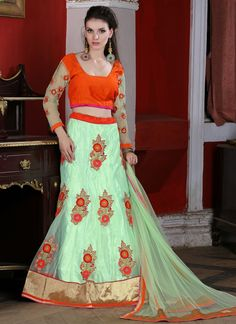 Style and design and trend would be at the peak of your splendor as soon as you dresses this green net a line lehenga choli. The embroidered, patch border and resham work seems to be chic and great fo...