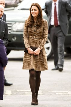 Middleton balances her Orla Kiely coat with brown opaque tights and ankle boots at the Oxford Spires Academy School in Oxford, England.   - ELLE.com