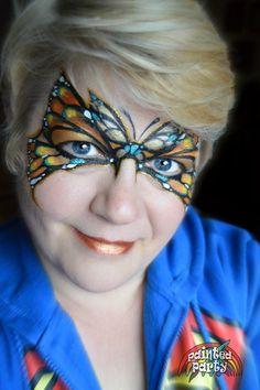 Orange, Gold & Teal Butterfly with FAB paints. Denise Cold, Painted Party Face Painting, www.PaintedParty.com