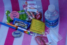 Back to school bag--Fruit by the foot, Pencils, rock, lollipop, eraser, rubber band, paper clips, Hershey Hugs, Smarties, Tootsie Roll, Sponge, Almond Joy candy--each item is labeled with good wishes