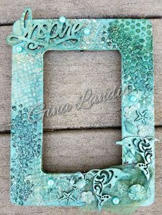 Mixed Media frame made with Lindy's stamp gang sprays, stencils, cheesecloth and other embellishments