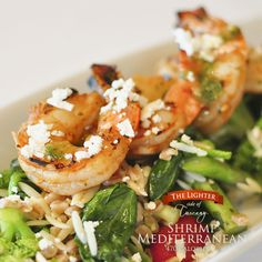 Spicy grilled jumbo shrimp on a bed of orzo and farro pilaf, broccoli, asparagus, tomatoes, spinach, Feta and pesto vinaigrette