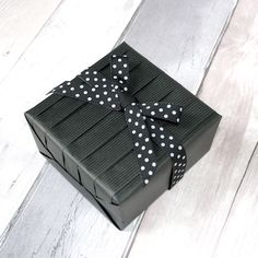 black pleated gift - Jane Means