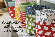 I am going to make some of theses for paper recycling bins in bedrooms  http://filminthefridge.com/2012/11/23/round-bottomed-fabric-storage-buckets-a-tutorial/