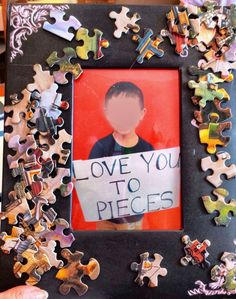 Photo frame craft for 4 year olds. Cardboard frame with puzzle pieces.