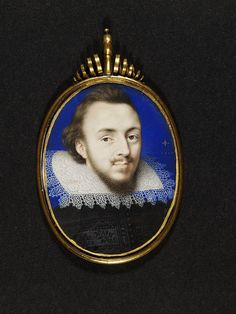 Lovely blue background, and pretty spiral embelishment on frame.  An Unknown Man by Isaac Oliver at the V 1610. Height: 55 mm, Width: 41 mm.