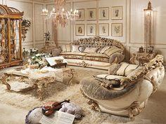 Гарнитур для гостиной от итальянского производителя Riva Mobili d'Arte. Состоит из двухместного дивана и журнального столика. Материал - массив древесины. Обивка предлагается текстильная в светлых тонах. Каждая из моделей украшена декоративной резьбой ручной работы.