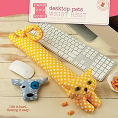 Desktop Pets Wrist Rest: Lying quietly at the base of your keyboard, this loyal dog or cat wrist rest gives your hands extra support while you type. And with a removable head to rest your hand on while you use the mouse, these two are sure to become your favorite fabric pets. And the best part? No shedding! X