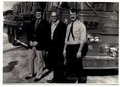 """ID#: 0151 Date: 1968 - 1975. This is a photo of (left to right) police chief Norm Schmidt, fireman Chuck Bailey and fire chief Doyle Jones. They are posed in front of the department's """"big"""" truck that had been acquired in 1968. Participant: Charles Bailey Additional Sources: Interview with Chuck Bailey, 01/23/01."""