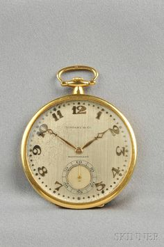 Art Deco Platinum and 18kt Gold Open Face Pocket Watch, Touchon & Co., Tiffany & Co., the silver-tone dial with Roman numeral indicators and subsidiary seconds dial, enclosing a 19-jewel manual-wind movement, inlaid gold monogram case back, no. 43607, 43 mm, signed dial and movement.