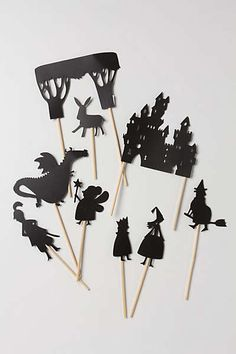 shadow puppets for telling the kids bedtime stories - DIY with black card stock and popsicle sticks