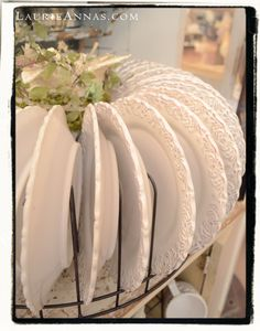 Love this round plate rack, can hold up to 32 plates. It's a favorite! At LaurieAnna's Vintage Home.