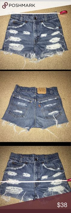 Vintage distressed levi's shorts Sadly reposhing because these were a little small for me. So cute, in perfect vintage condition! They have a 13 inch waist but i'd say run smaller, best for size 24-25. Levi's Shorts Jean Shorts