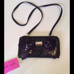 Betsey Johnson Cross-Body Back Black NWT Betsey Johnson Cross-Body Back. Black with Black sequins Bow, Gold-tone hardware. Multiple card slots, multiple bill slots, inside zipper compartment. Removable strap, can be used as a wallet Betsey Johnson Bags Crossbody Bags