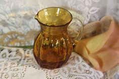60-70\'s  Studio Glass Amber Pitcher/Creamer. Starting at $15