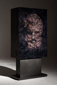 """""""Dionysus"""" - A cocktail cabinet made from black Valchromat and rippled Sycamore wine shelfs with a spectacular glass print by Lee Fieldman: Surface Print & Pattern Designer. By Roi Klifi"""