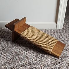 Our cat likes to scratch things. When she started scratching a custom upholsteredchair (see it here) I immediately placed a corrugated, compressed, cardboard cat scratcher next to the chair hoping she would take a liking to the scratcher. Well, it worked, she has never scratched the chair since! While the cardboard scratcher did providea solution …