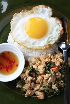 Pad Ka-Prao (ผัดกะเพรา) - my favorite recipe from punyaratabandhu's cookbook. I use a less soy sauce and less fish sauce, which I think suits our family's taste buds a bit better. LOVE the egg on top.