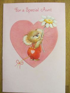 Hallmark card. Mouse holding daisy. I would like to buy this card. Thanks.