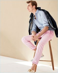 French model Clément Chabernaud dons a J.Crew denim jacket with a slim lightweight oxford shirt. Clément also wears J.Crew lightweight garment-dyed chinos and Vans for J.Crew canvas sneakers.