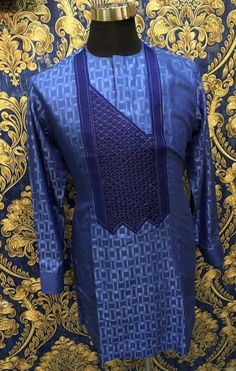 Call, SMS or WhatsApp if you want this style, needs a skilled tailor to hire or you want to expand more on your fashion business. African Shirts For Men, African Dresses Men, African Attire For Men, African Clothing For Men, African Wear, African Fashion Traditional, African Inspired Fashion, African Print Fashion, Tribal Fashion