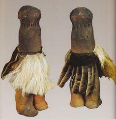 South African Fertility FiguresZulu male figures (udoli) wearing imitsha made by Hluphekile MaMchunu Zuma 1990. Photo by Action…View Post