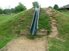 I wanted to post about playground hills today. Almost every person I talk to wants a hill in their learning landscape, with an embankment slide of course. It is kind of a trademark of natural play. Most folks picture a grass hill that is perpetually… Read Backyard Slide, Sloped Backyard, Backyard For Kids, Backyard Landscaping, Kids Yard, Backyard Ideas, Playground Slide, Backyard Playground, Playground Ideas