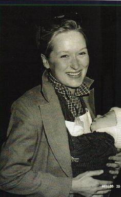 With her first born baby, Henry, in 1980  -Can I be Meryl Streep's child?? please