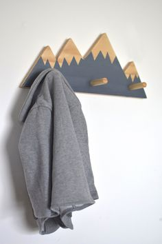 (LIMITED EDITION) Exclusive Mountain Peak Wall Hooks Are you looking for both an original and stylish way of hanging up yours or your little ones belongings? This one of a kind, Limited Edition Mountain Peak Wall Hooks is ready to spruz up your room. MATERIALS This Wall hook is crafted by high-quality, FSC Certified Pine Hardwood. This wood is sourced sustainably and is both eco-friendly and ethical. This design is coloured using low odour water-based paint and finished with a combination of…