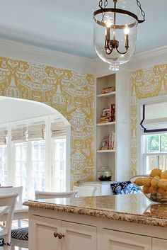The Vase Wallpaper in yellow and blue ceilings, adding sunny charm to a kitchen nook! In House of Fifty Mag