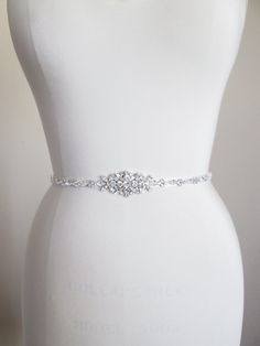 This sparkly skinny bridal belt is made with top quality Swarovski crystals beaded on 3/8 wide grosgrain ribbon. The crystal part of the belt