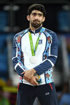 Silver medalist Toghrul Asgarov of Azerbaijan stands on the podium during the…