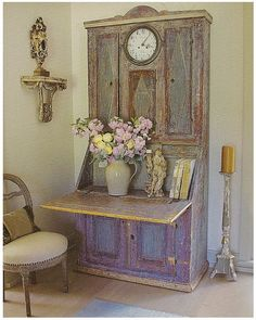 Aqua-blue mixed with purple. Charming piece wit that clock inset!!